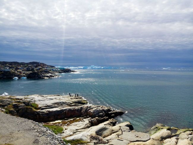 Beautiful Serene Arctic Summertime in Ilulissat with huge Icebergs and Blue Sky