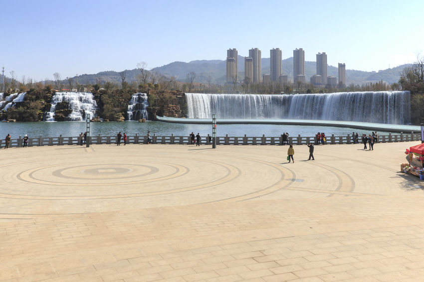 Kunming, China - March 4, 2016: Kunming Waterfall park featuring a 400 meter wide manmade waterfall. Kunming is Yunnan's capital Architecture Built Structure Capital Cities  China City City Life Cityscape Dali Yunnan Day Dianchi Lake Indochina Kunming Kunming, China Lijiang Niulan River Outdoors People Southeastasia Tourism Tourists Travel Destinations Water Waterfall Park Xinhua Yunnan