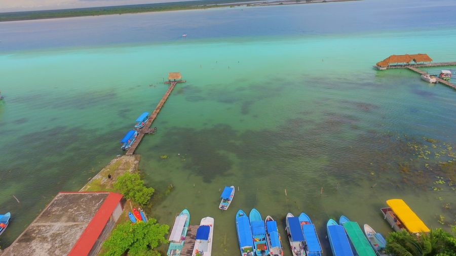 Bacalar Lagoon Bacalar Blue Lagoon Mexico Beauty In Nature Day High Angle View Nature Nautical Vessel No People Outdoors Reflection Tranquil Scene Tranquility Transportation Water Waterfront