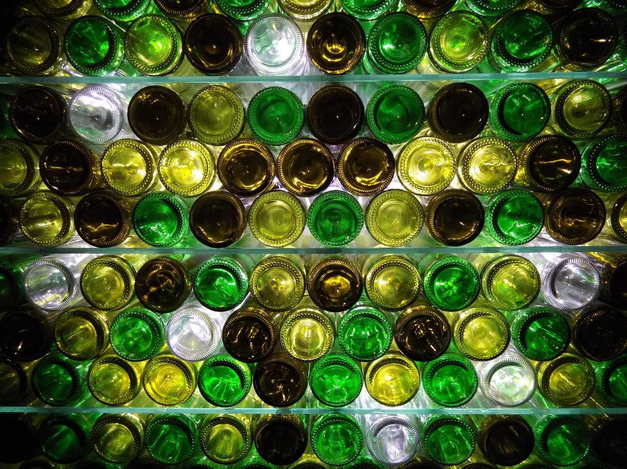 FULL FRAME SHOT OF MULTI COLORED GLASS BOTTLES