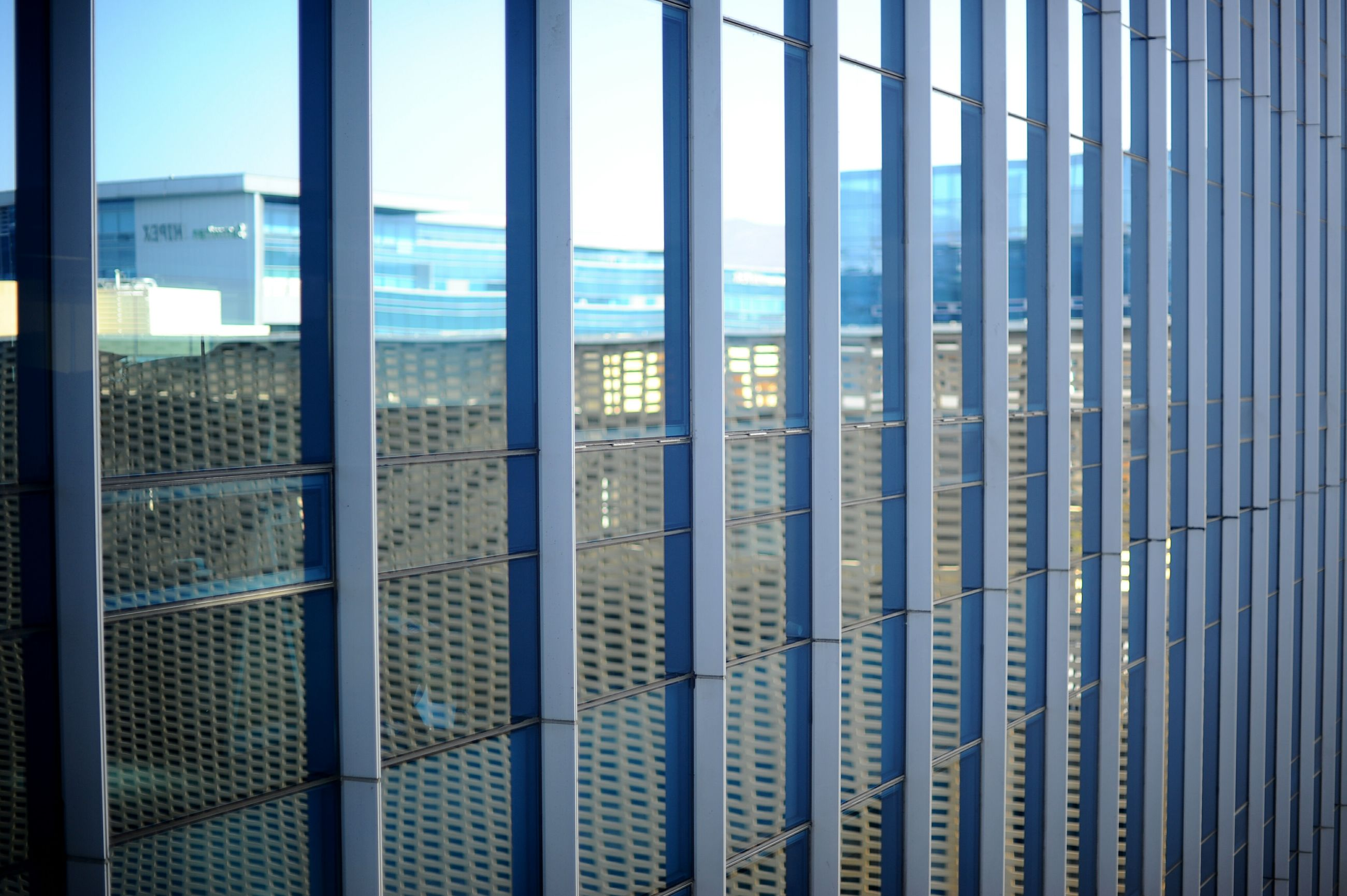 architecture, window, built structure, indoors, glass - material, pattern, sea, transparent, day, modern, building exterior, no people, repetition, sunlight, city, architectural column, metal, sky, design, protection