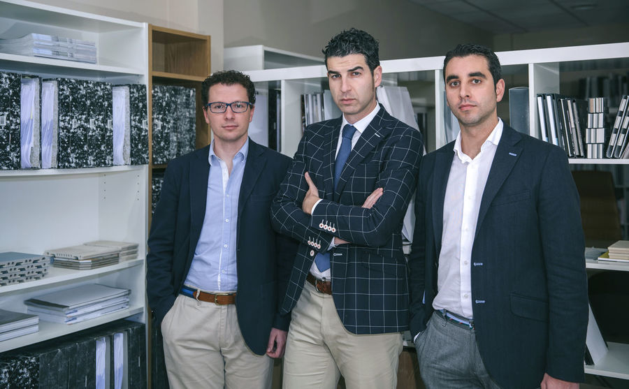 Portrait of three businessmen standing and looking at camera in the office Business Company Horizontal Man Office Teamwork Woman Working Workplace Business Finance And Industry Businessman Businesswoman Caucasian Chairman Chief Female Headquarters Male People Portrait Professional Seriousface Sucess Team Three People