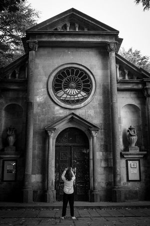 Monochrome Photography Architecture Standing Leisure Activity Architecture Woman Taking Photos Lifestyles Standing Leisure Activity Built Structure Building Exterior Full Length Casual Clothing In Front Of History Façade Front View Person Outdoors Footpath Day Historic Entrance Arch
