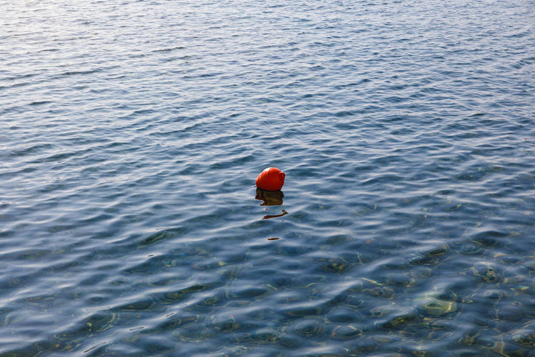 High Angle View Of Red Buoy Floating On Sea