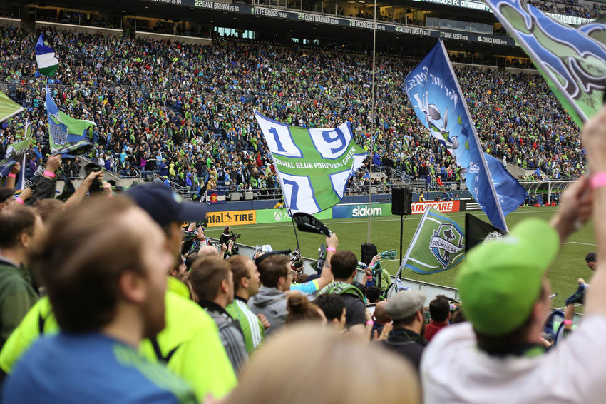 Casual Clothing City Life Crowd Day Fans Green Color Group Of People Information Sign Large Group Of People Leisure Activity Lifestyles Medium Group Of People Men Mixed Age Range Outdoors People Soccer Sounders