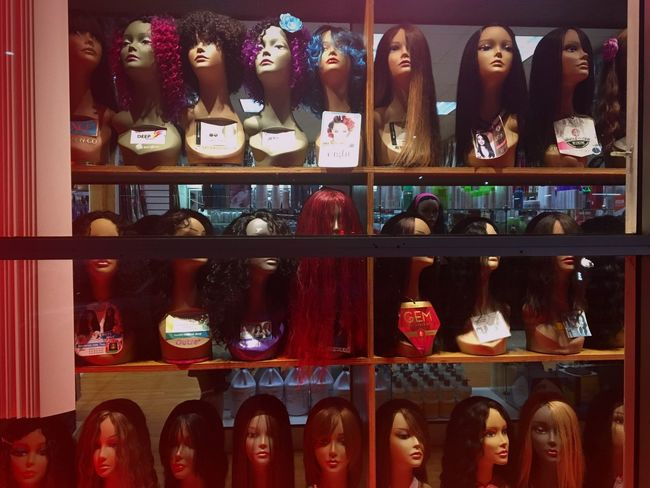 It's a party Variation Choice Retail  Shelf Large Group Of Objects Store Indoors  In A Row Multi Colored No People Mannequin Mannequins Heads Dolls Red Oakland