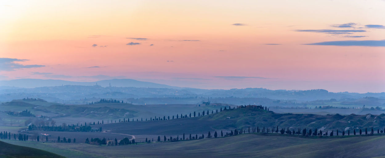 Winter sunset in the Crete Senesi Beauty In Nature Cityscape Cypress Day Dusk Hills Landscape Morning Nature No People Outdoors Refraction Scenic Scenics Shades Sky Sun Sunset Travel Destinations Urban Skyline View Winter