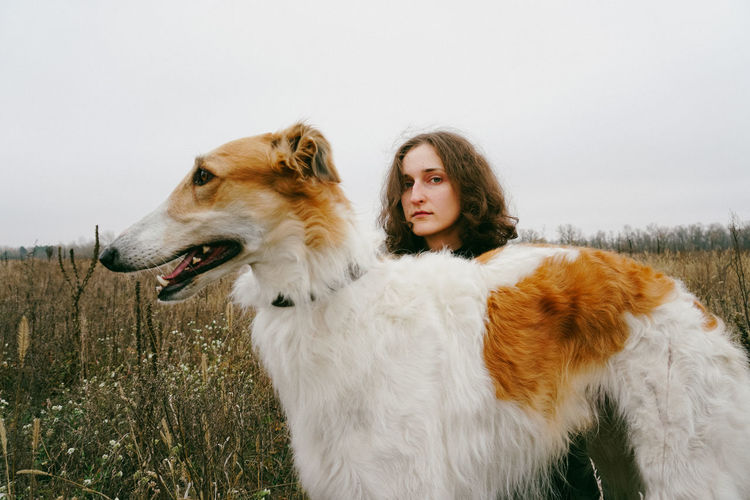 Domestic Animals Domestic One Animal Dog Canine Mammal Pets Looking At Camera Young Women Hairstyle Pet Owner Young Adult Nature One Person Portrait Portrait Of A Woman Sad Sadness Dogs Dogs Of EyeEm Hunter Hunting Field Autumn Land Autumn Mood