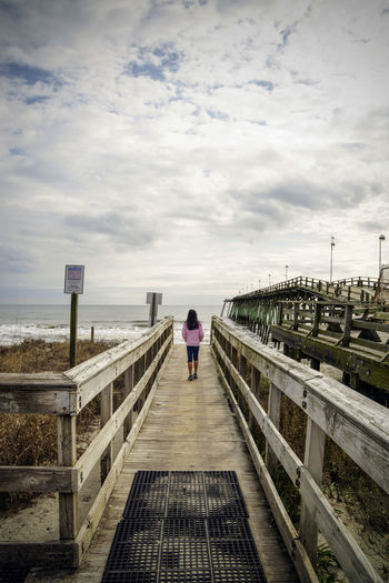 Path to the Ocean Bridge - Man Made Structure Clouds And Sky One Person Pathway Pathway To Heaven Pier Pier Rear View Sky Sony A6000 Sony Photography Water