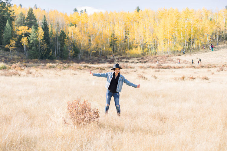 Full length of man standing on field during autumn
