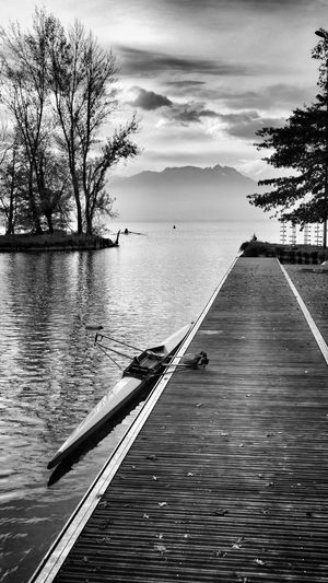 Scenic view of pier over lake against sky