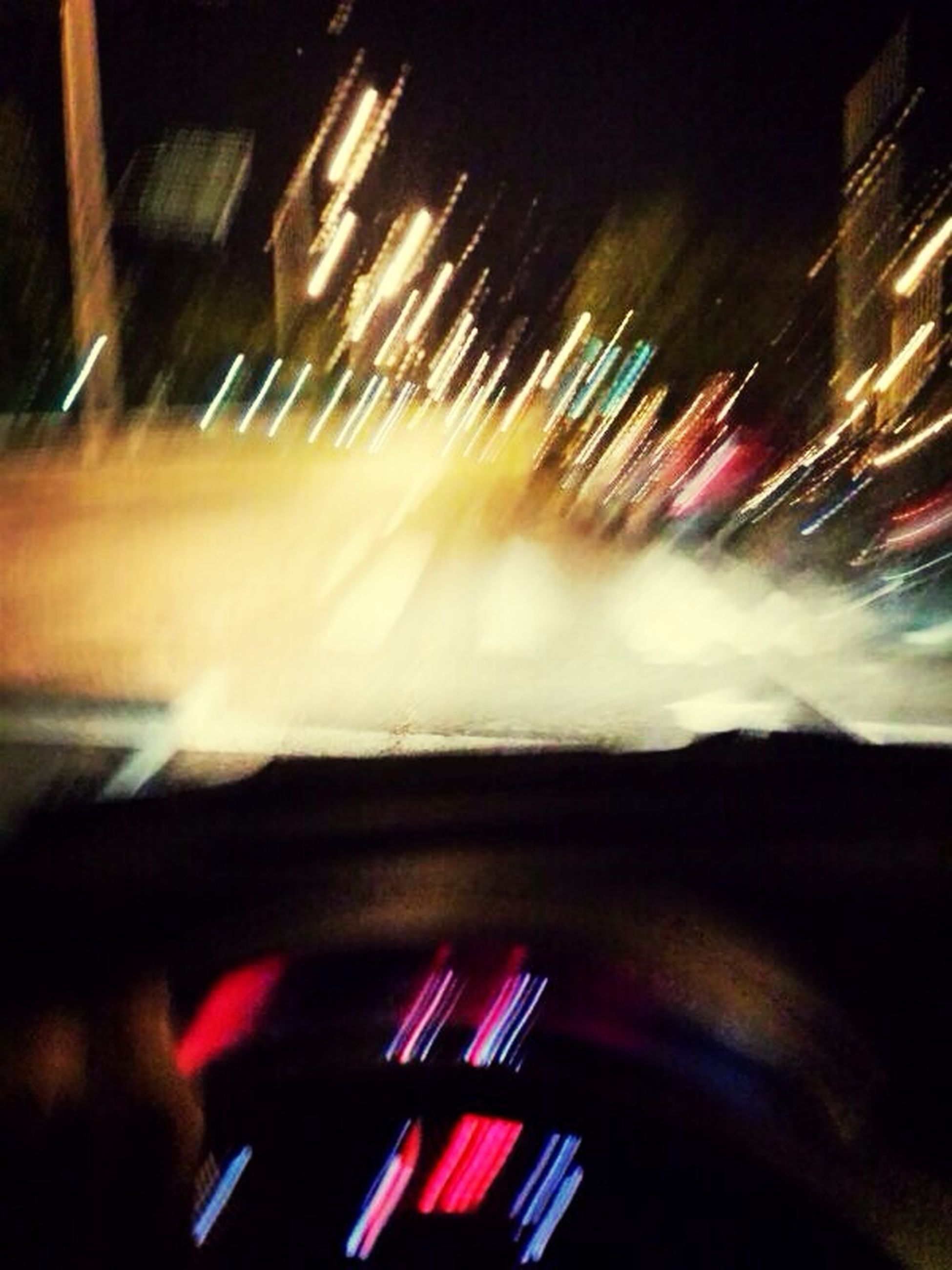 night, indoors, illuminated, blurred motion, transportation, motion, speed, mode of transport, arts culture and entertainment, long exposure, selective focus, multi colored, land vehicle, music, close-up, no people, light - natural phenomenon, high angle view, car, light trail