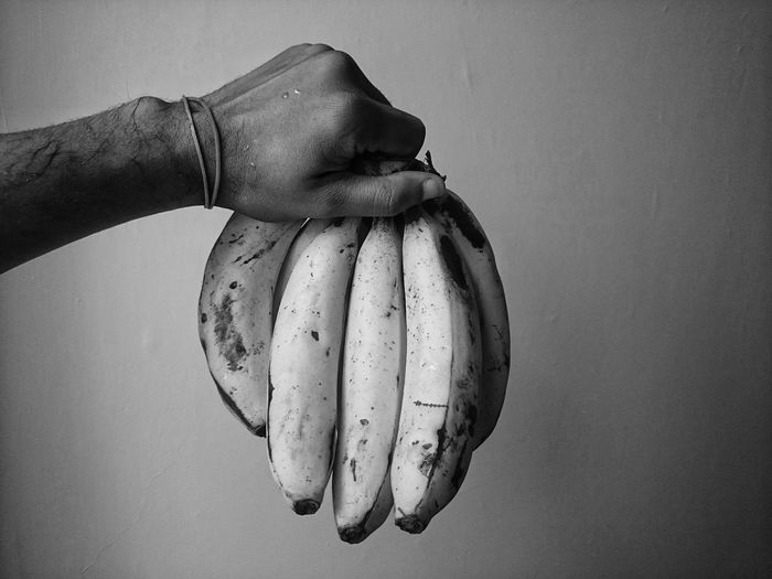 Light And Shadow Eye4photography  Fruit Banana Foodporn Foodphotography EyeEm Best Shots Eye4photography  EyeEmBestPics EyeEm Best Edits EyeEm Best Shots - Black + White Human Body Part Holding First Eyeem Photo Fruits Human Arm Hand Blackandwhite Black And White Black & White Eating Eating Healthy Fresh Check This Out Indoors  EyeEm Gallery Hello World Human Hand Close-up Food And Drink This Is My Skin