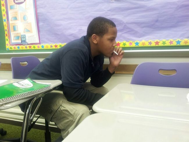 #old but he up in school smoking fake cigarettes and shit...he don't get no effect lol