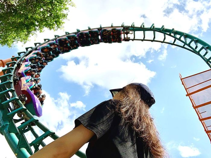Low angle view of woman ride against sky