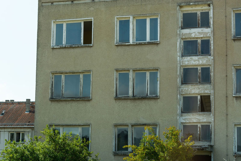 Typical building in East Germany with precast concrete parts with copy space Window Building Exterior Built Structure Architecture Building Residential District No People Day Outdoors Glass - Material Low Angle View Nature City Plant Reflection In A Row Backgrounds Apartment Sky Side By Side