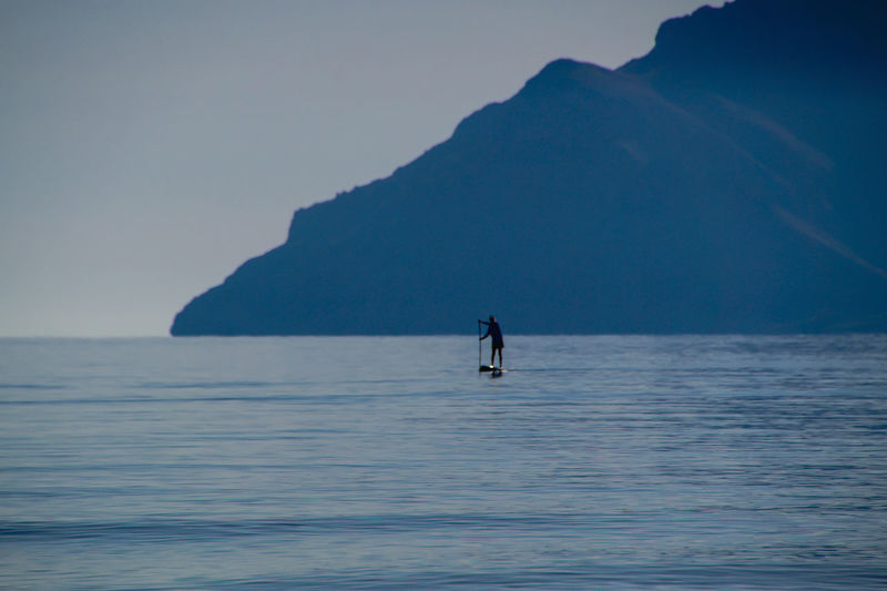 stand up paddling The Still Life Photographer - 2018 EyeEm Awards Creative Space The Traveler - 2018 EyeEm Awards This Is Aging Adventure Beauty In Nature Blue Calm Day Horizon Over Water Idyllic Leisure Activity Lifestyles Mountain Nature Non-urban Scene Outdoors Scenics Sea Sky Stand Up Paddling Tranquil Scene Tranquility Unrecognizable Person Vacations Water Waterfront Breathing Space An Eye For Travel Inner Power Summer Sports