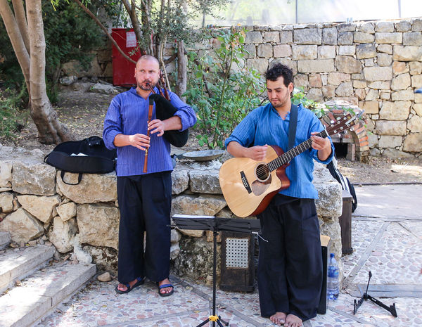 Jerusalem, Israel -September 19, 2013: street musicians playing in the street on the bagpipes and guitar in Jerusalem, Isarel Arts Bagpipes Casual Clothing City Concert Cultures Day Entertainment Equipment Festival Guitar Israel Jerusalem Leisure Activity Lifestyles Men Musical Musician Performer  Playing Pop Scene Sound Street Urban