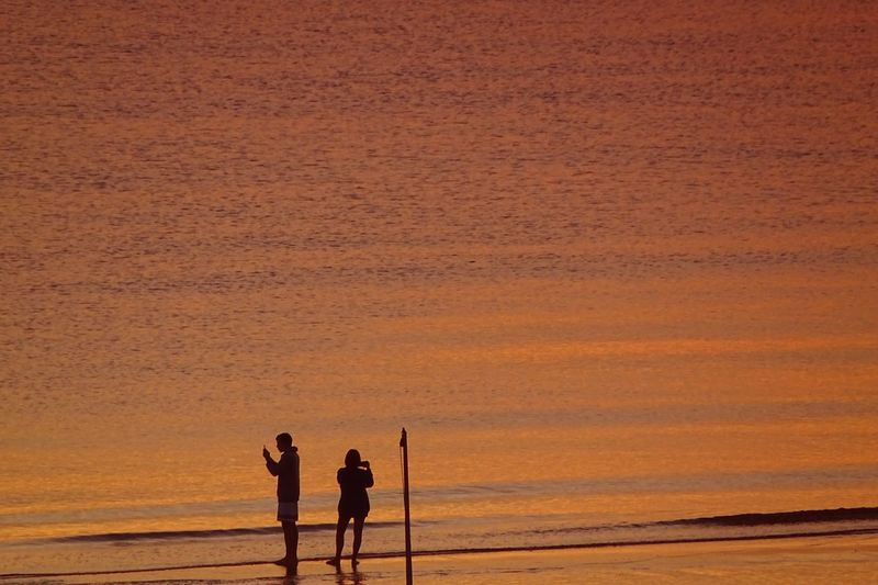 Sunrise Sunset Two People Land Togetherness Men Real People Sky Leisure Activity Orange Color Beach Scenics - Nature Adult Sea Lifestyles Tranquility People Beauty In Nature Nature Women