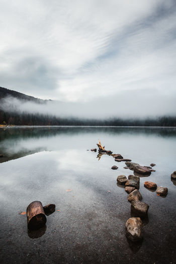 Water Lake Sky Cloud - Sky Tranquil Scene Tranquility Beauty In Nature Scenics - Nature Nature Non-urban Scene Reflection No People Solid Idyllic Day Stone - Object Rock Waterfront Stones Tree Trunk Fog In The Trees Fog Over Water Moody Sky Reflection Landscape_Collection