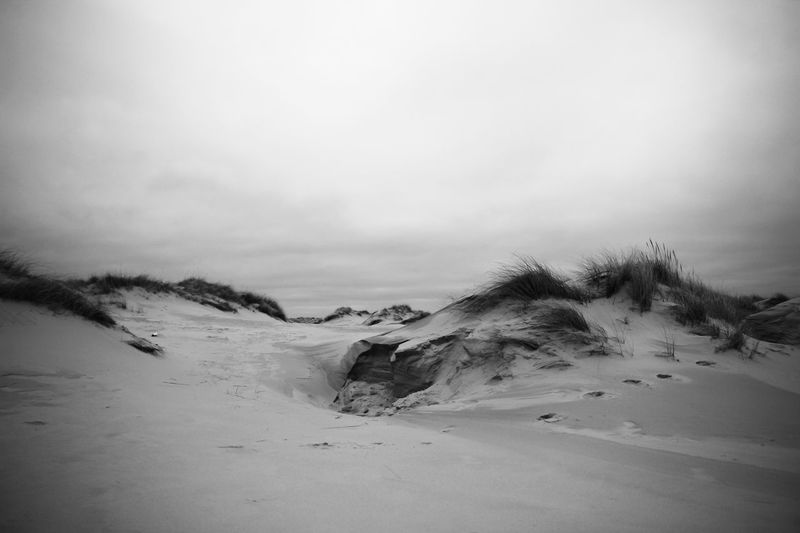 Amrum – February 2015 17-70mm Amrum B/w Beauty In Nature Blackandwhite Canon EOS 600D Dunes Dünen F/4.0 Footsteps Insel Island ISO 100 Landscape Nature Nordsee S/w Tranquil Scene Tranquility Vacations Winter Wolken