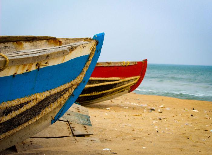 Boats On Beach Against Clear Sky