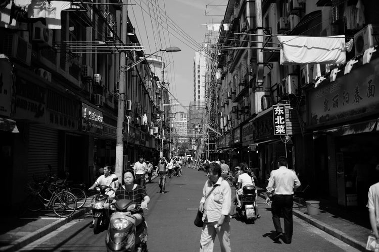 Architecture Black And White Blackandwhite Building Exterior Building Story Built Structure Casual Clothing City City Life City Street Crowd Day Full Length Large Group Of People Lifestyles Men Monochrome Monochrome Photography Narrow Outdoors Person Road Street The Way Forward Walking