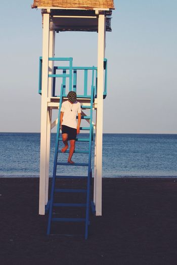Young Man On Lifeguard Tower