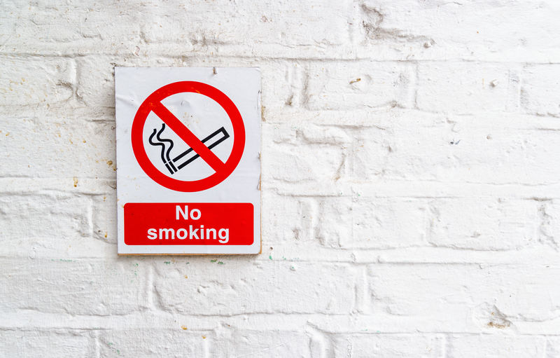No Smoking Sign On White Wall