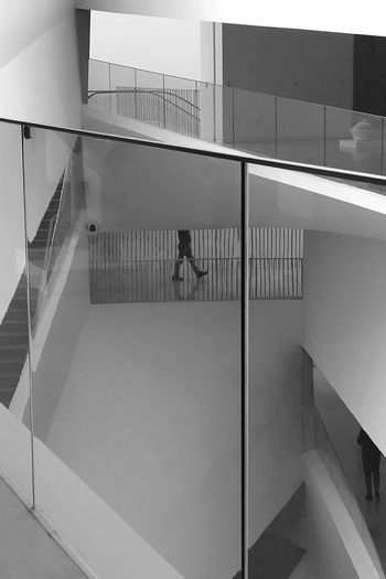 Non Recognizable People Real People People Architecture Staircase Steps And Staircases Built Structure Railing Indoors  Building Pattern Modern Day Glass - Material Design Reflection