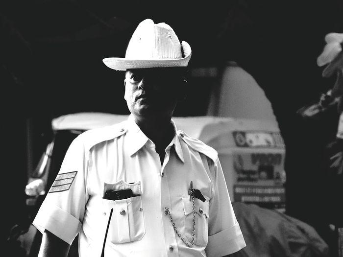 Traffic Cop Wearing Hat Looking Away