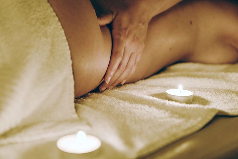 Cropped Image Of Therapist Massaging Woman At Spa