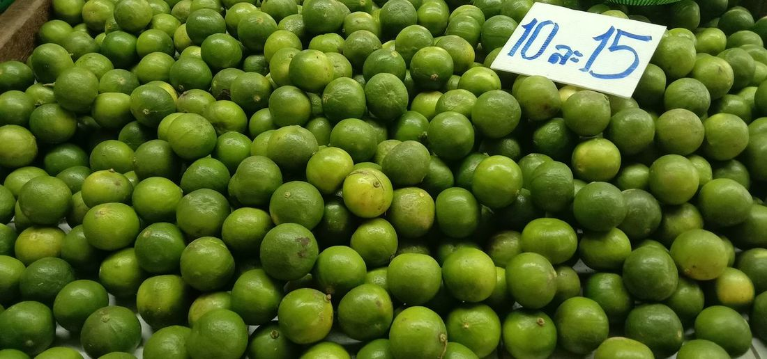 Close-up of green fruits for sale in market