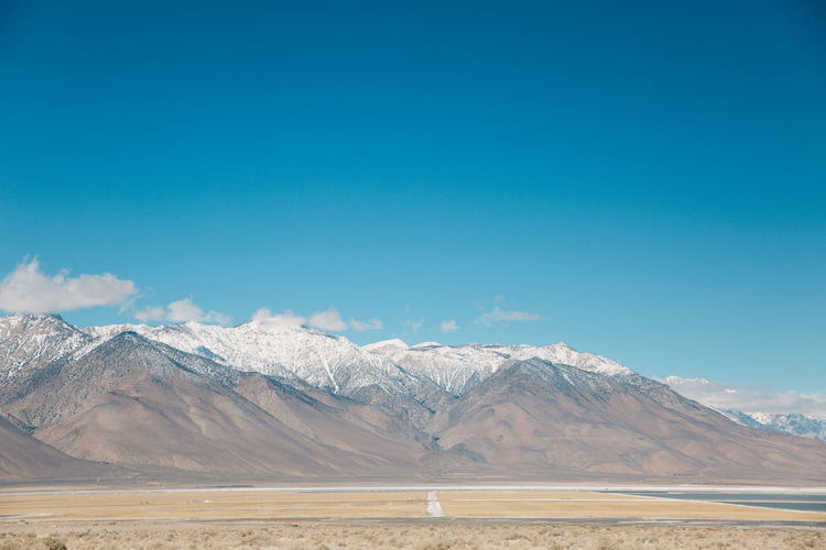 Scenic view of salt flats and mountains at death valley desert