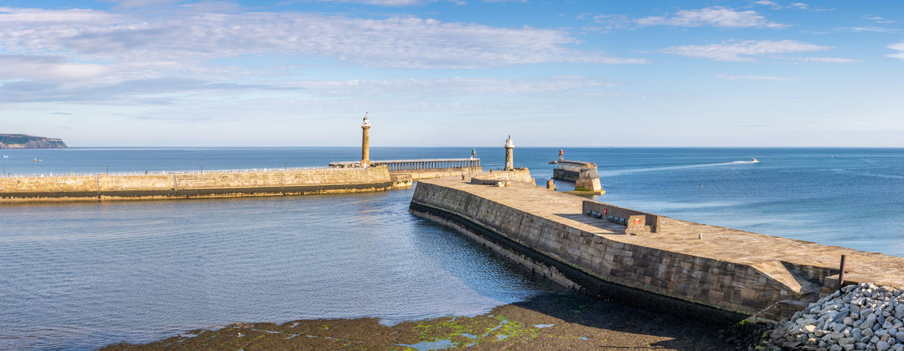 Whitby Harbour Entrance and Piers England, Europe, UK Entrance Lighthouse North Yorkshire Pier Whitby Harbour Whitby Harbour Entrance Yorkshire Coast Beauty In Nature Built Structure Fishing Industry Historic Horizon Over Water Idyllic Outdoors Sea Seaside Sky Tranquil Scene