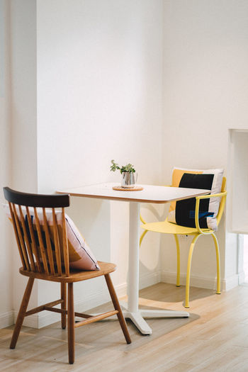 Table and chairs on hardwood floor at home