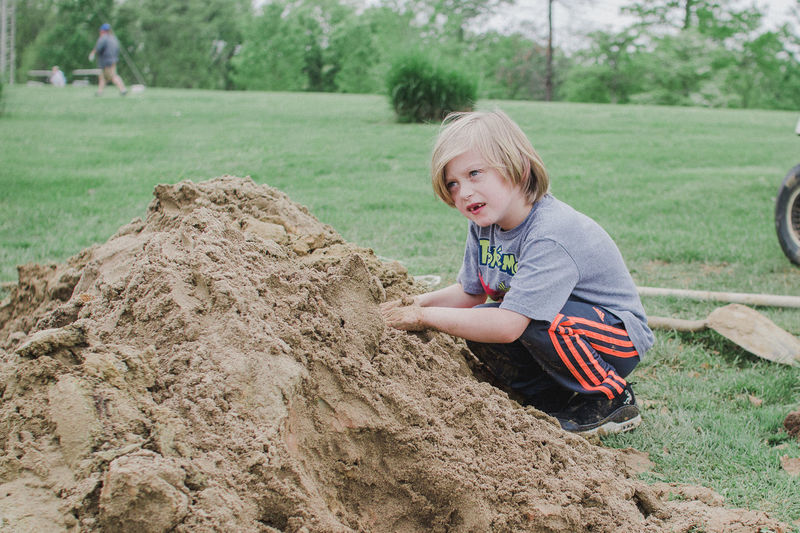 Concentration Digging Dirt Hardwork Kids Being Kids Piles Of Dirt Play To Learn Playing Working