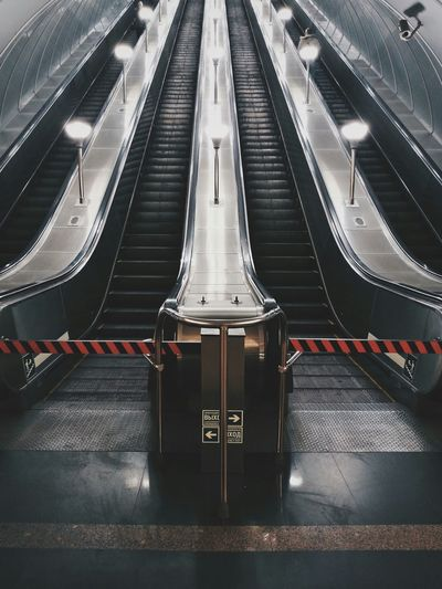 Symmetrical view of escalators in underground station