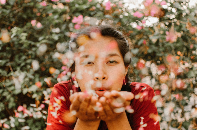 happiness. Portrait Headshot Front View Young Adult One Person Flower Looking At Camera Day Plant Lifestyles Leisure Activity Flowering Plant Human Hand Close-up Focus On Foreground Nature Human Body Part Real People Human Face Hand