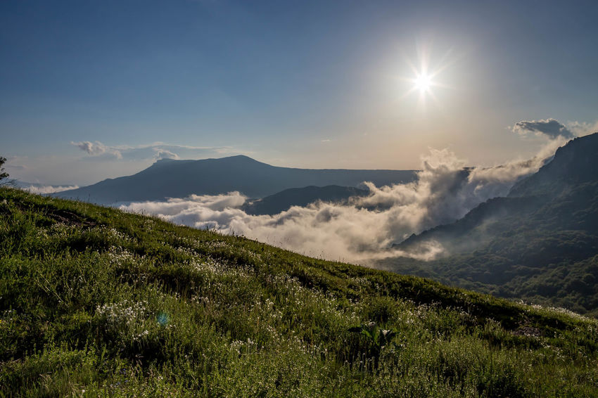 Beauty In Nature Bright Cloud - Sky Day Environment Idyllic Land Landscape Lens Flare Mountain Mountain Range Nature No People Non-urban Scene Outdoors Plant Remote Scenics - Nature Sky Sun Sunlight Tranquil Scene Tranquility