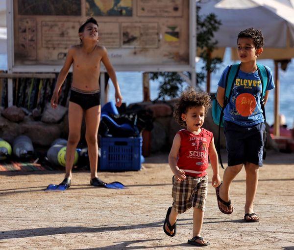 Portrait of happy siblings standing outdoors