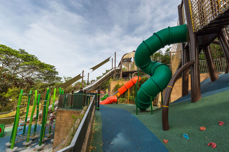 Playground - Admiralty Park. Modern loops, twirls and slides Architecture Built Structure Cloud - Sky Day Green Color Jungle Gym Nature No People Outdoor Play Equipment Outdoors Park Park - Man Made Space Plant Playground Railing Sky Slide Slide - Play Equipment Tree