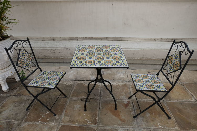 High angle view of empty chairs and table