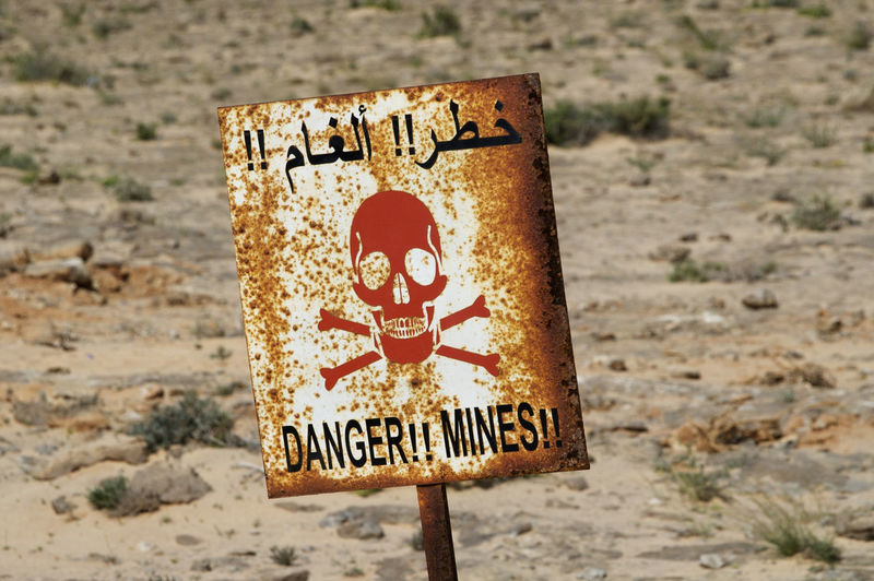 Mines along the road through the Western Sahara on the road to Mauritania Danger Sign Desert Sahara Desert Sign Danger Danger Mines Dangerous Dangerzone Mines Rusty Rusty Sign Sahara Sand Sighn Signboard Skull Skull Face Western Sahara