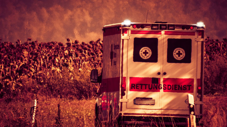 Lifesavers Hospital Agriculture Ambulance Car Communication Field Land Land Vehicle Lifesaver Mode Of Transportation Motion Nature No People Outdoors Plant Red Rettungswagen Rural Scene Sign Sky Text Transportation Travel Tree Western Script