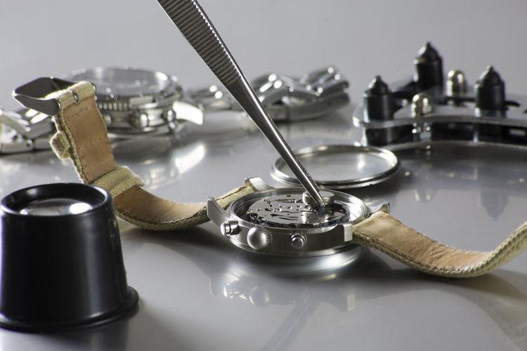 Close-up of wristwatch repairing at workshop