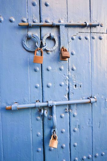 Close-up of closed door with padlock