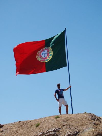 Full Length One Person Flag Front View People Standing Adult Adults Only Day Outdoors One Man Only Clear Sky Sky Only Men Real People Flying Men Politics And Government Portugal Flag Top View Mountain This Is Masculinity EyeEmNewHere Inner Power