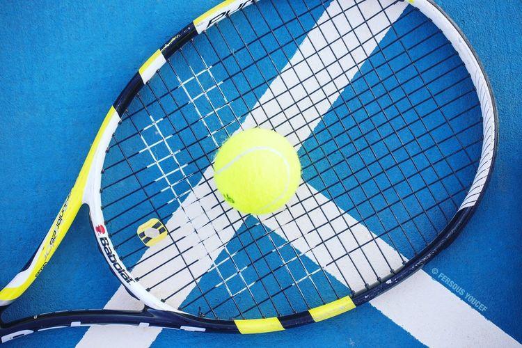 tennis ball and racket EyeEm Selects Tennis Court Tennis Ball Sport Tennis Racket Blue Racket Sport Yellow Close-up Racket Tennis Net Yard Line - Sport Ball Sports Equipment Serving - Sport