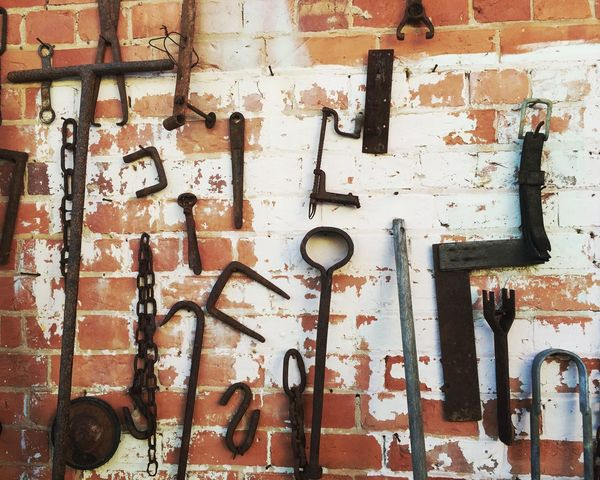 Tools on a brick wall 2 Architecture Backgrounds Bad Condition Brick Wall Built Structure Cable Close-up Day Deterioration Full Frame No People Obsolete Old Outdoors Pipe - Tube Run-down Tools Wall Wall - Building Feature Weathered